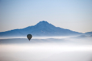 A hot air balloon over the clouds