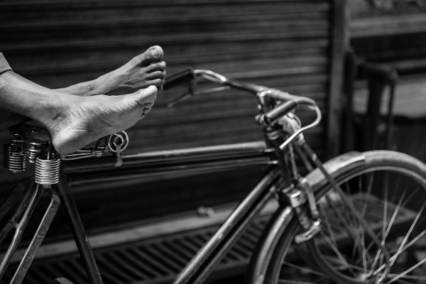 Close up of feet on a bicycle