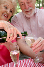 old couple pouring wine