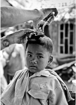 Boy Getting A Haircut In Sumatra