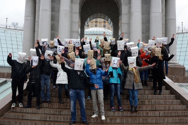 People with paper bags over their heads for flash mob