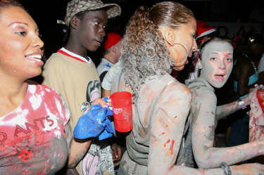 Revellers slathered in something at J'Ouvert