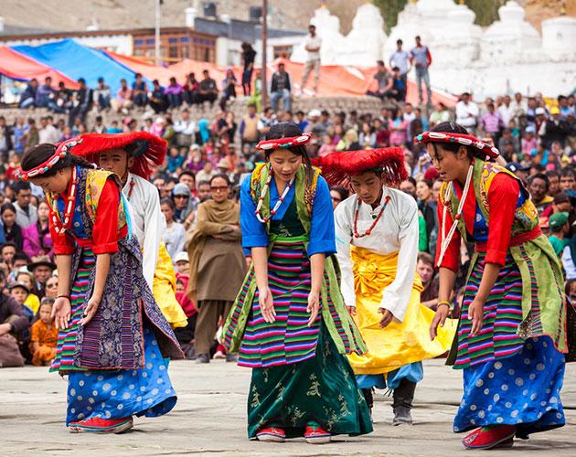 Ladakhi people perform a dance