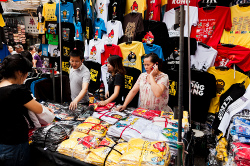 Tourist buying t-shirts
