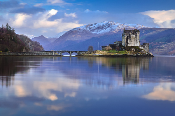 Eilean Donan Castle surrounded by mountains