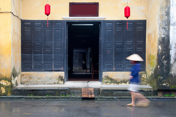 Man walking past doors in Vietnam